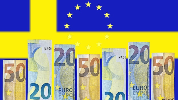 Euro banknotes rolled up in a tube against the background of the flag of sweden