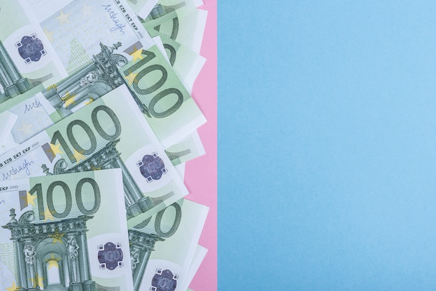 Euro cash on a blue and pink background. euro money banknotes. euro money. euro bill.