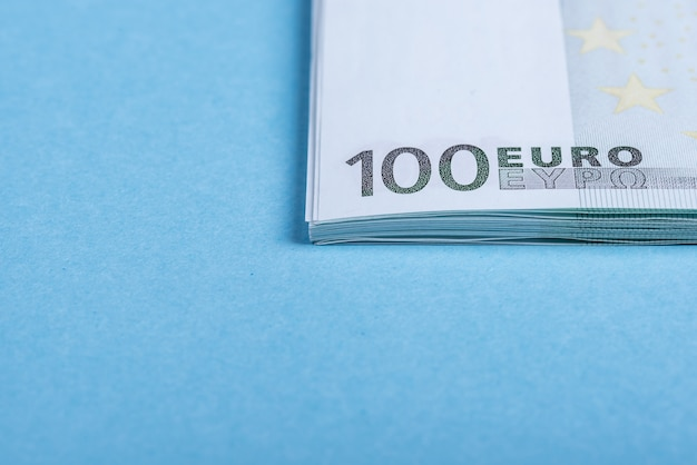Euro cash on blue and pink. euro money banknotes.