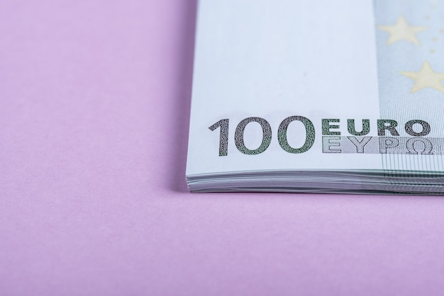 Euro cash on a lilac background