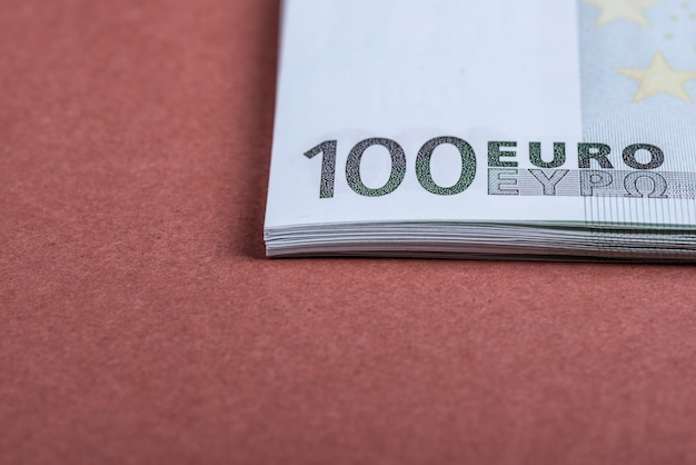 Euro cash on a pink and brown. euro money banknotes. euro money. euro bill.