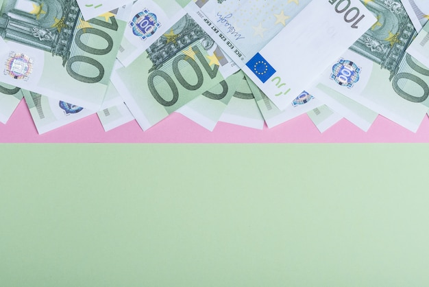 Euro cash on a pink and green.