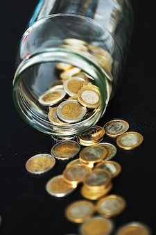 Euro coins in a glass jar