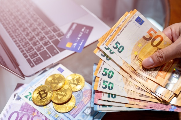 Euro currency and bitcoin electronic money for online purchases.