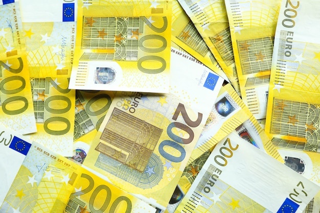Euro currency, offers 200 euro bank note on table