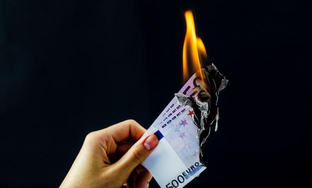 Euro is burning on black isolated background