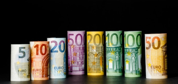 Euro money background. several hundred rolls of euro banknotes in different positions.