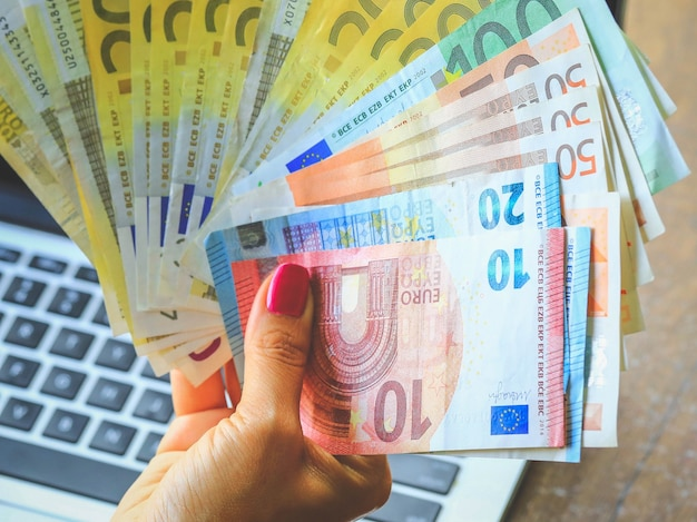 Euro money in business woman hand. business concept