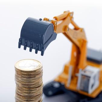 空白の掘削機とユーロマネーコイン