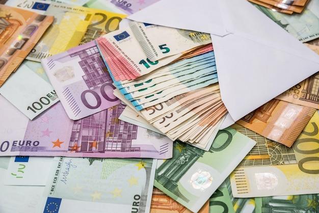 Euro in white envelope on euro banknotes