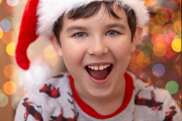 European boy in christmas jumper and santa claus