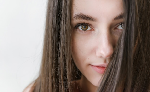 European brunette woman with long hair face close up, russian girl