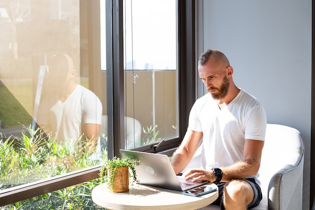 European business man in white shirt does distance work