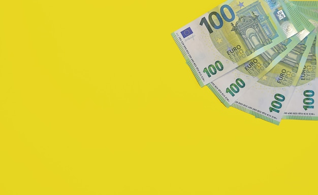 European currency banknotes isolated on a yellow background.