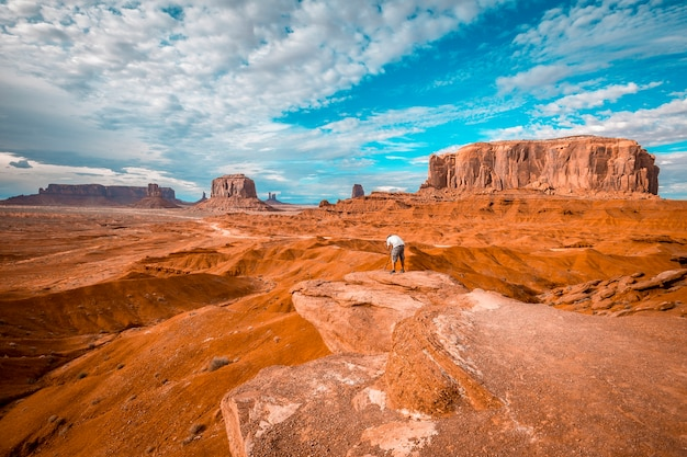 A european photographer at john ford's point in monument valley.