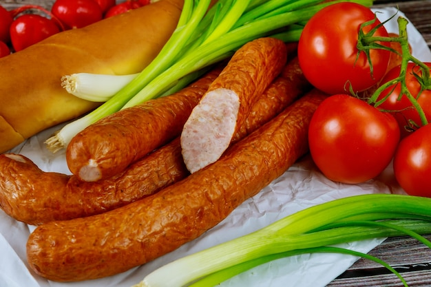 European smoked sausage with green onion and bread.