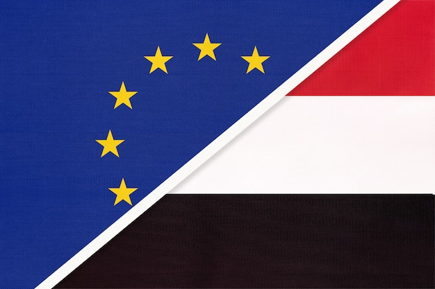 European union or eu and republic of yemen or yaman national flag from textile.
