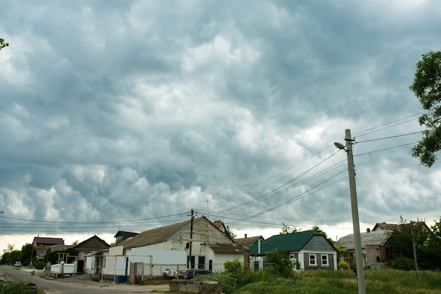 European village with old houses against a stormy sky