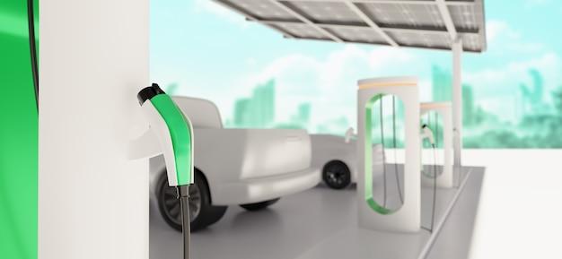 Зарядка автомобильной стоянки на современной зарядной станции с солнечными батареями и зеленым городом на заднем плане Premium Фотографии