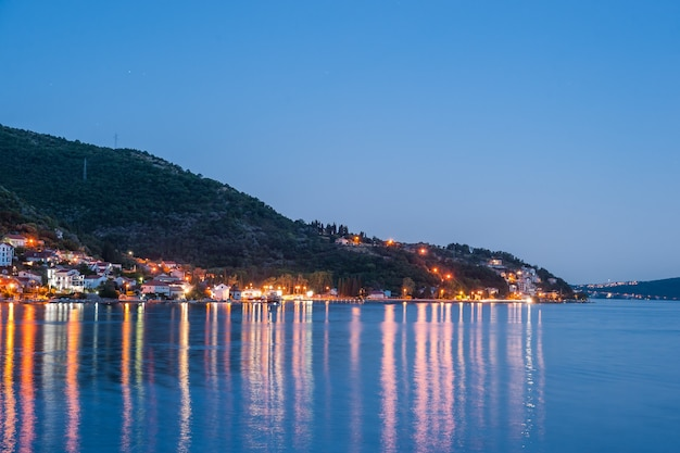 Evening at boka kotorska bay with lanterns, travel landscape, dobrota, montenegro