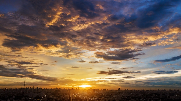 Evening cloudscape in city, colorful sunset