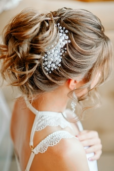 Evening hairstyle with a beautiful hairpin, rear view