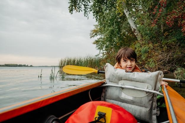 Evening kayak trip along the river in autumn