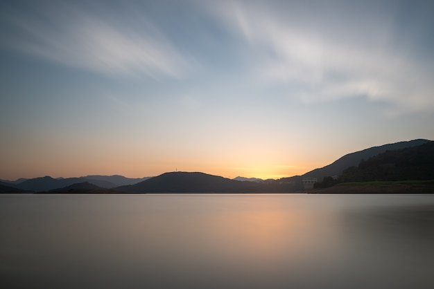 The evening lake reflected the mountains and the sky on both sides;