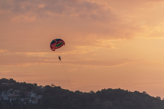 Evening parasailing on the beach of patong, phuket province, kingdom of thailand