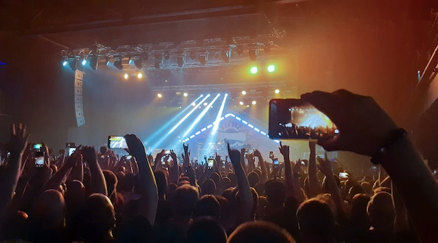 Evening rock concert in front of a large audience in the club