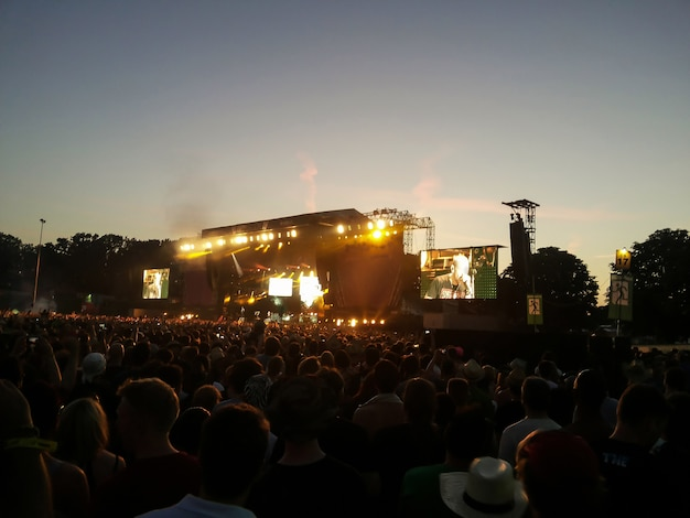 Evening rock concert in front of a large audience in the open air
