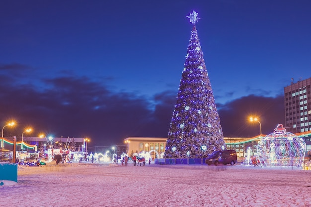 Evening in the town square with a christmas tree