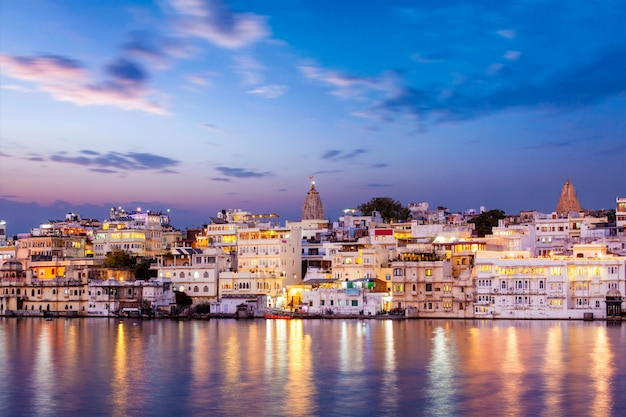 Evening view of illuminated houses on lake pichola in udaipur