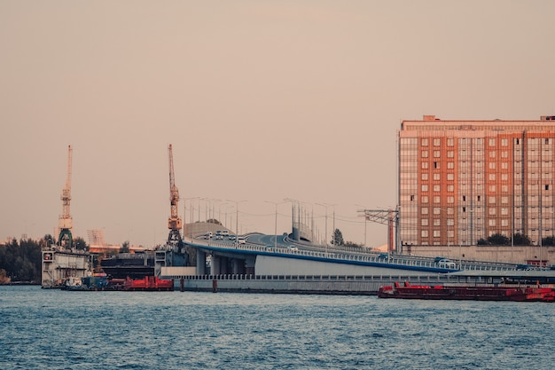 Evening view of st. petersburg with traffic through the viaduct. shipyards of an industrial enterprise shipbuilding company almaz. russia.