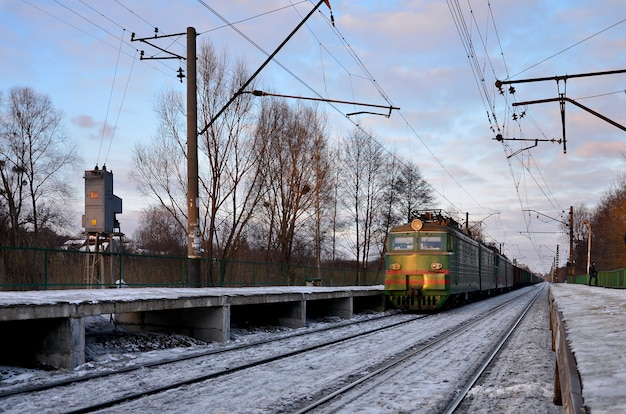 Evening winter landscape with the railway station