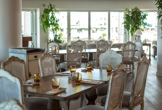 Event hall wooden table with rustic chairs