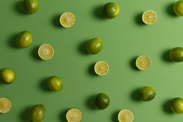Evergreen edible tropical citrus limes provides juice or peel to food dishes for refreshing, tart flavor. fruit used in baked goods and desserts, popular alcoholic beverages. nobody on photo