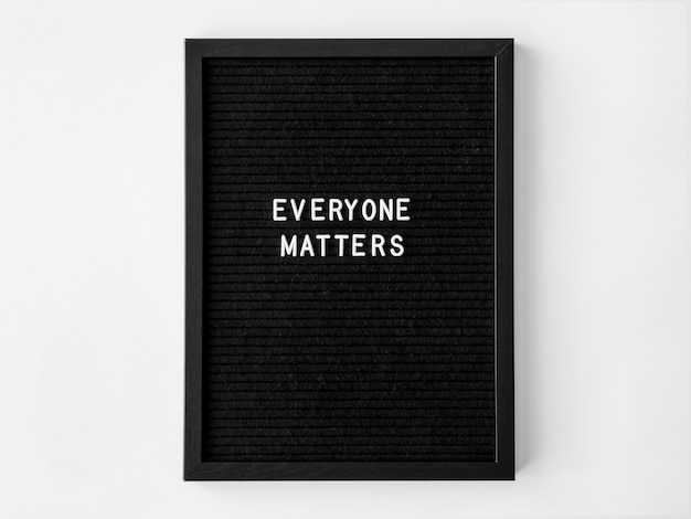 Everyone matters quote on a black fabric with frame