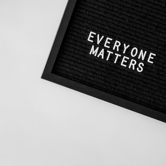 Everyone matters quote on black fabric