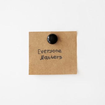 Everyone matters quote written on a piece of paper