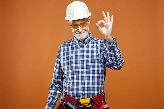 Everything is under control. portrait of eldelry mature caucasian handyman with thick beard