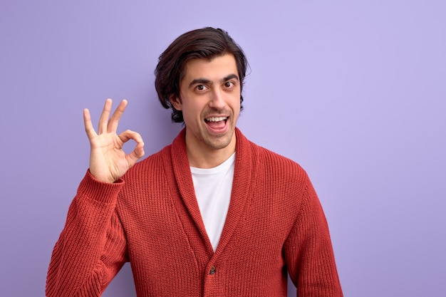 Everything will be ok. man showing ok gesture at camera