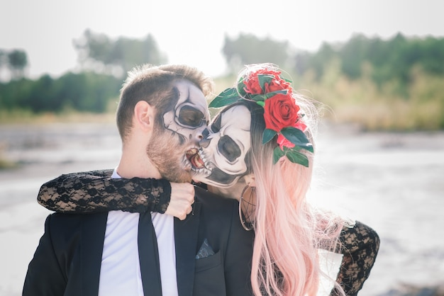 Evil day of the dead undead couple posing, halloween make up