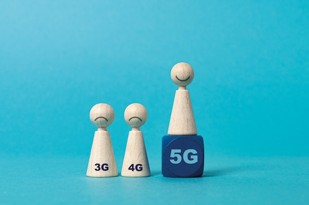 Evolution of mobile generation network connecting technology wooden figures cubes with letter g and numbers blue background