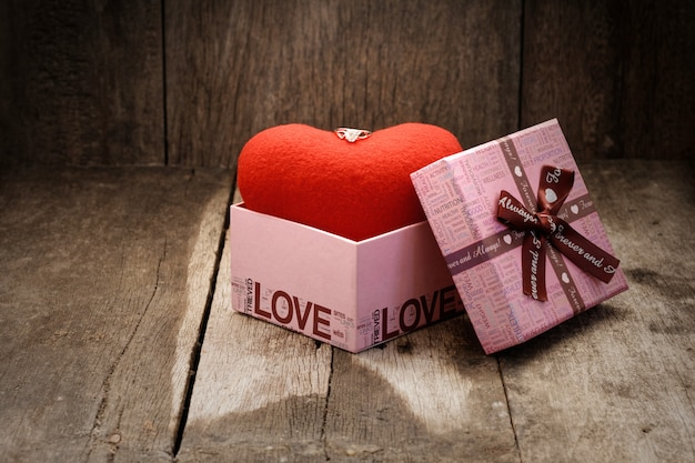 Ewelry ring on top heart in the gift box.