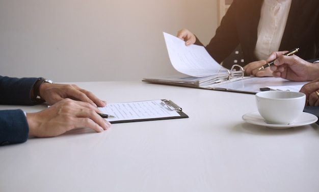 Examiner reading a resume during  job interview at office business and human resources concept