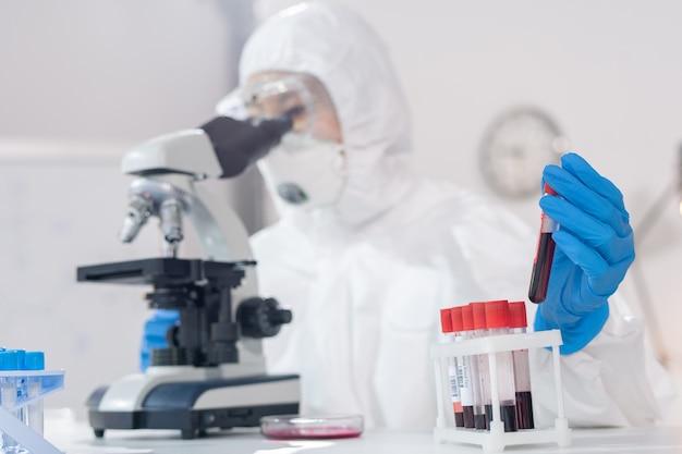 Examining blood samples under microscope