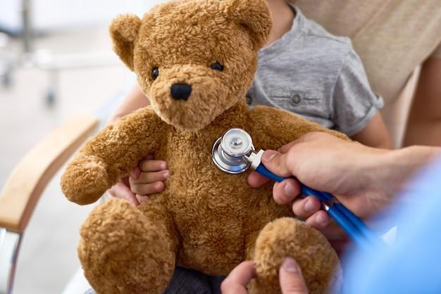 Examining plush teddy bear