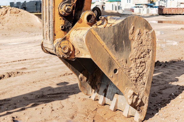 Excavator bucket close up. excavation work at construction site and road construction. construction machinery.