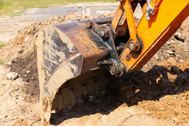 Excavator bucket during road and construction works.
